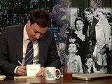 Photo of Jimmy Fallon writing a thank you note
