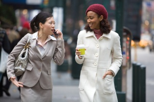 Photo of two business women walking