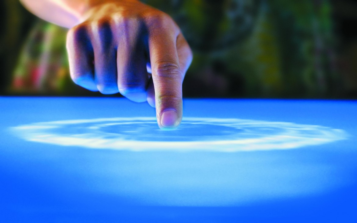 finger pointing on a screen creating a ripple